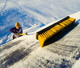 Sweeping snow from solar panels.
